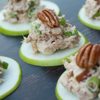 apples sliced thin with chicken salad and a whole pecan on top - beautiful and tasty appetizer idea