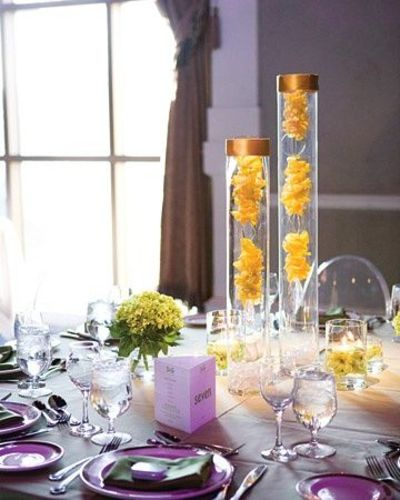 Yellow Centerpiece Tall Vases Topped With Bangles Hold Chain