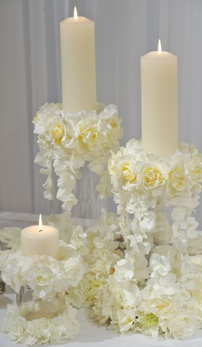 use basic candle holders and decorate with lush flowers