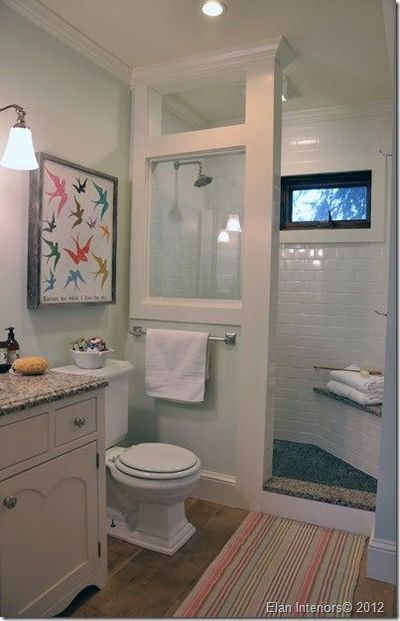 doorless shower setup and i love the subway tile and the glass