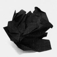Not sure how a crumpled piece of black paper with dots on it looks like the cosmos... but it does to me
