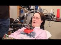 Quadriplegic Jan Scheuermann has been able to feed herself for the first time / via