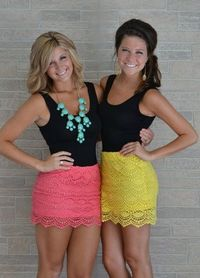 Black top with a colorful lace skirt. Perfect for summer!