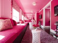 this raspberry pink room looks as if it is a mile long thanks to well position mirrored walls. #interiordecor #livingroom #pinkpaint #homedecorating #smallspaces