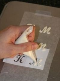 What an elegant idea! Put stencils under wax paper for chocolate letters....simply trace and then you have a gorgeous cupcake topper..