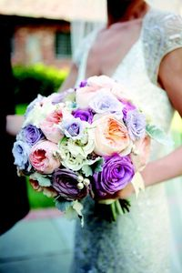I love the colors in this bouquet! My mom sent me a picture a while ago that had all of the bridesmaids with cream roses, matching the bride's gown, and the bride's bouquet had cream and muted colored flowers matching each of the bridesmand's ...