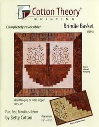 Reversible quilt and placemats by Betty Cotton