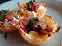 Blue Ribbon recipe , Nested Potato Skins , Just a Pinch recipe Comments from the Test Kitchen: What a fun idea - potato skins... without the skins! Not only are these little guys tasty and cute, but they are also a great trick for controlling portion size...