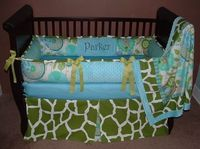 Urban Safari Baby Bedding This Custom baby crib bedding set includes bumper pad, blanket, and crib skirt. This set will be easy to coordinate with multiple shades of green, aqua, blue, tan, and chocolate. Your little one will love cuddling with the ultra ...