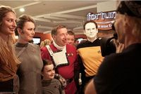 Shatner photobombs unsuspecting Star Trek fans. He rules.