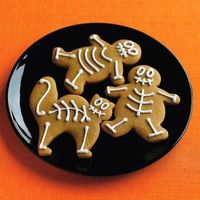 Decorate skeleton cookies