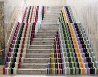 "staircase ""accessorated"" (accessorized/decorated) using frame pieces in a missoni-style flame stich pattern."