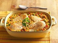 A one-dish dinner showcases moist, tender chicken on top of zesty, colorful rice.
