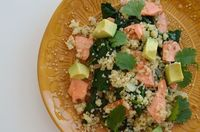 quinoa topped with spinach, salmon, and avocado