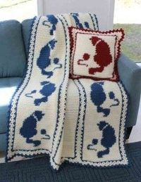 Cats create a calming image in many peoples minds. While these fun animals like to play and jump around, they also like to curl up in a ball and cuddle in a chair. Keep warm this winter with the playful Cat and Mouse crochet afghan. The sample afghan show...