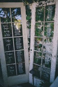 Old Doors with glass paint for a seating chart.