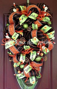 This colorful Halloween Swag is made with black and orange striped deco mesh purchased from http://www.trendytree.com. For more of my wreaths visit me at http://www.facebook.com/ADOORableDecoWreaths