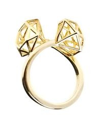 Gold plated ring with double gold cage diamond finials.