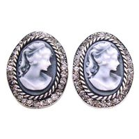 Earrings features a delicate carved portrait of a lady Vintage Beautiful new inspired Cameo jewelry versatile stunning Cameo earrings in Oval Shaped with Lady Cameo carved with artistic work around the frame with Black Diamond Crystals embedded all over t...