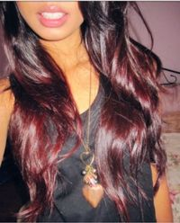 Brown to red ombre hair .