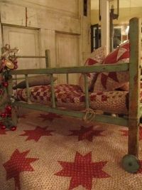 Old Quilt and Baby Bed.