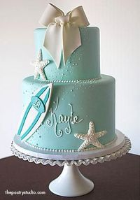 Beautiful 2 tiered beach themed cake. Perfect for a bridal shower or as the surf loving groom's cake. #celebstylewed