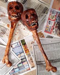 Hmmmm....baby rattles, maracas, drumsticks? Replicate with dollar store bones and inexpensive skulls that have been aged.