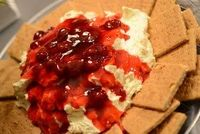 Cheesecake dip Prepare Jello No-Bake Cheesecake mix as directed on box. Stir in one container of Cool Whip. Chill. Top with a can of cherry pie filling. Serve with graham crackers.