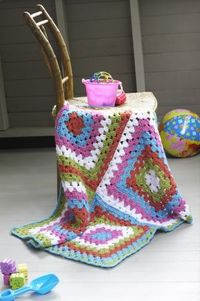 The Granny's Baby Throw, crocheted with Vanna's Choice Baby, is a modern take on the classic granny square, worked in four pieces and seamed up the middle. The color combinations for this bold throw are endless!