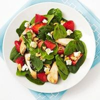 Spinach Salad with Chicken, Strawberries, Walnuts, and Goat Cheese Combine 3 cups baby spinach, 2 ounces chopped grilled chicken, 1/2 cup sliced strawberries, 1/2 ounce crumbled goat cheese, 2 tablespoons chopped walnuts, 2 teaspoons olive oil, and 1 tabl...