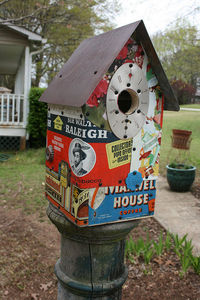Wing Ding Constructions birdhouse. Salvaged lumber, tin, vintage can parts. 6x6x12.