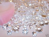 These faux diamonds are sparkling clear and look just like the real deal. They measure 6.5mm, 8mm, and 10mm across Approximately the size of 1 carat, 2 carat, and 4 carat diamonds. Mixing sizes together adds dimension to your elegant confetti display.