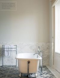 white marble bath and free standing tub