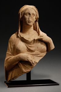 Hellenistic marble half statue of a goddess, probably Demeter. Wearing a chiton, her himation over her head (capite velato). Ca. 325-250.