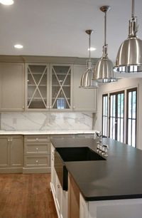 kitchens - Restoration Hardware Benson Pendant white kitchen island honed black quartz countertop warm gray painted butler's pantry glass-front cabinets marble countertops marble slab backsplash