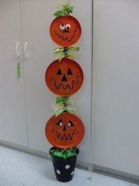 Pumpkins made from dollar store stove burner covers.