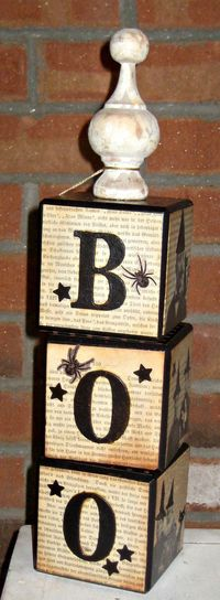 These BOO blocks are no longer for sale but would be easy to make with wood blocks, old book pages, scrapbook paper or music sheets. Stamp ink rubbed on gives it the vintage look and the finial on top is found in the unfinished wood section and painted. M...