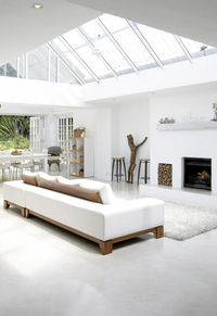 Like the lighter concrete floor and wood tones, white rug is cool too