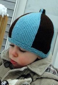 Garter Stripe Hat--This fun and easy pattern is knitted sideways in garter stitch without a single seam. The garter stitch brim is picked up and knitted after the rest of the hat is done. The stripes add just a splash of color to an adorable baby to child...